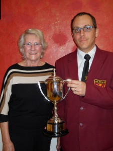 Stuart Briggs receives the Harry Farnsworth Cup for bandsmanship on behalf of his nephew Michael Briggs from Councillor Mrs Jean Bradley